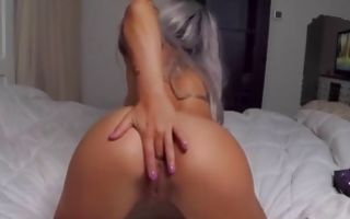 Blonde babe fucking her pussy with purple dildo