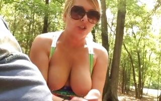Sexy blonde blowing his dick outdoors wearing shades