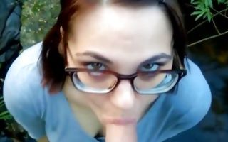 Teen brunette on her knees swallowing huge dick