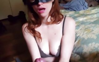 Fierce babe with a face mask swallowing huge dick