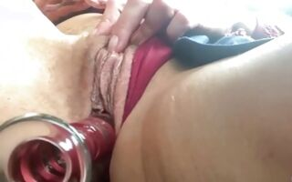Horny bitch with shaved pussy fucking her cunt