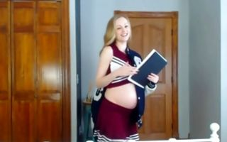 Cute pregnant college girl poses nicely in homemade xxx video