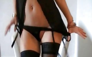 Chick in hot clothing showing ass and fingering muff