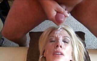 Raunchy blonde milf enjoys bukkake getting cum all over her face