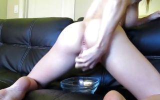 Blond poking tight pussy hole with dildo posing on sofa hd