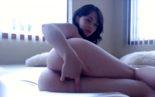 Cute brunette girlfriend fingers her pussy in homemade solo