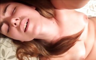 Absolutely cute brunette fingers her clit and moans so loud